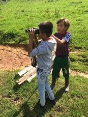 Pancho's son and a neighbor check out my binoculars